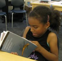 Photo of student reading workbook on urban natural environments