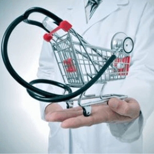 health care worker holding mini shopping cart with a stethoscope in it
