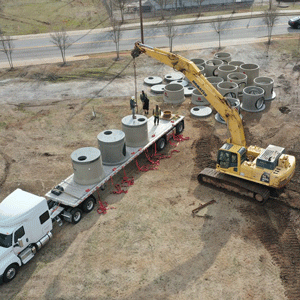 trucks hauling pipes for park infrastructure