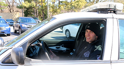 Patrol officer in his car, leaving the LEC